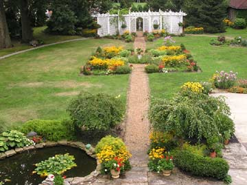 Mid August view of center gardens and pond